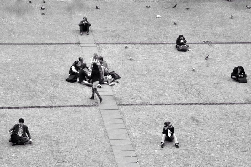 People Sitting At Town Square