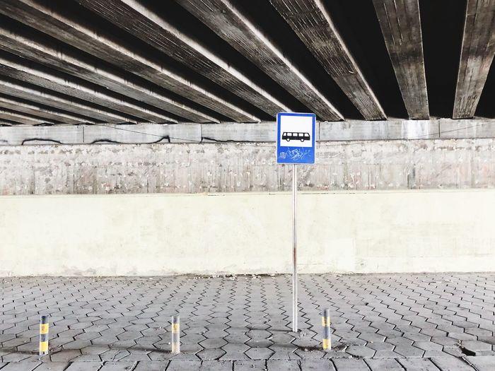 Bus stop under a bridge