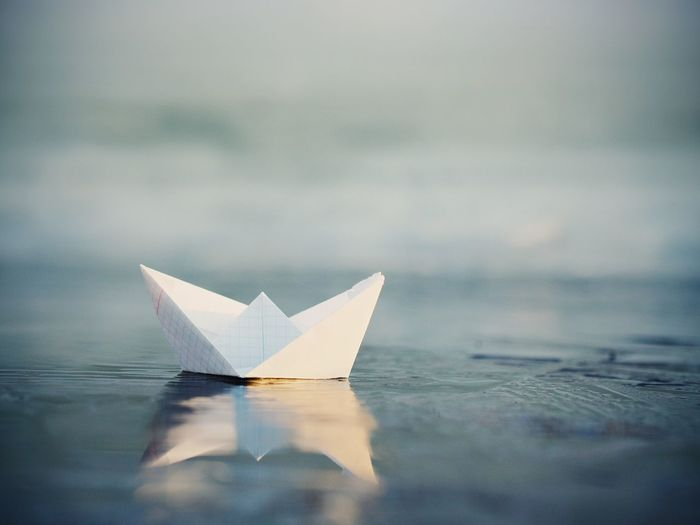 Close-up of paper toy floating on water