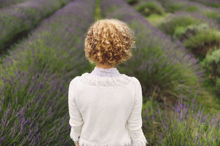 Rear view of woman against a lavender field