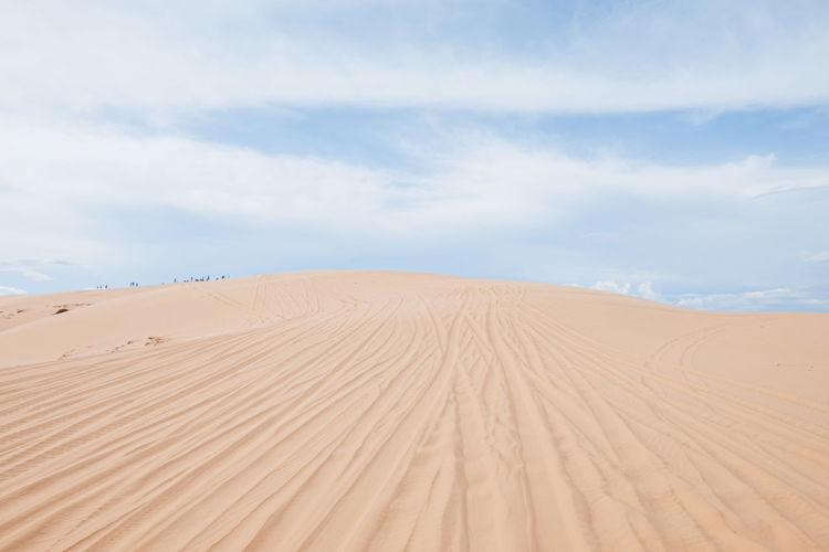 White sand dunes at muine vietnam. White Sand Beach Dunes Dune Muine Vietnam ASIA Travel Beautiful Cloudy Cloud Sky Day Desert Landscape Nobody Outdoor Sandune Sandy Summer Tourism View Blue