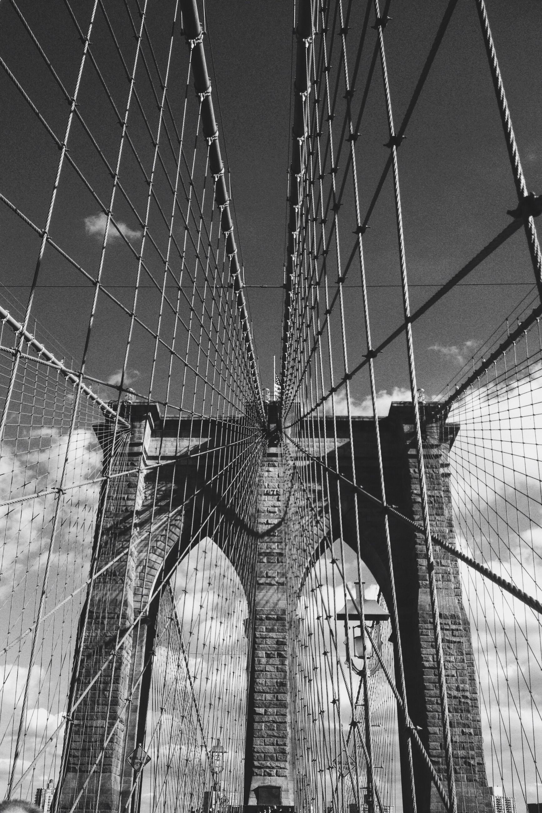 built structure, architecture, bridge - man made structure, low angle view, connection, engineering, modern, transportation, city, metal, building exterior, famous place, capital cities, sky, suspension bridge, travel destinations, travel, day, tall - high, outdoors
