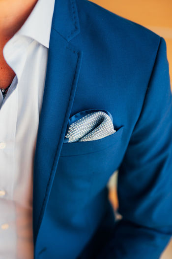Midsection of man in blazer