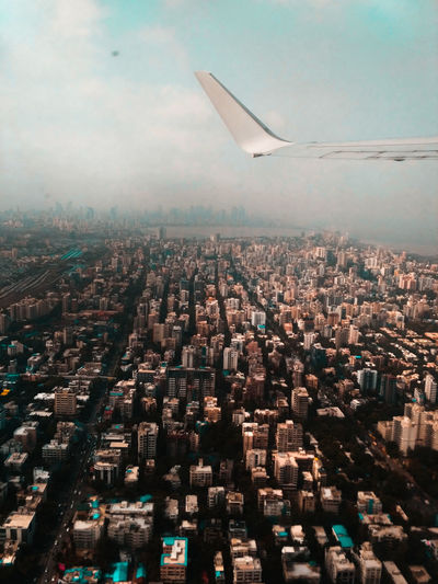 View Of Cityscape Seen Through Airplane