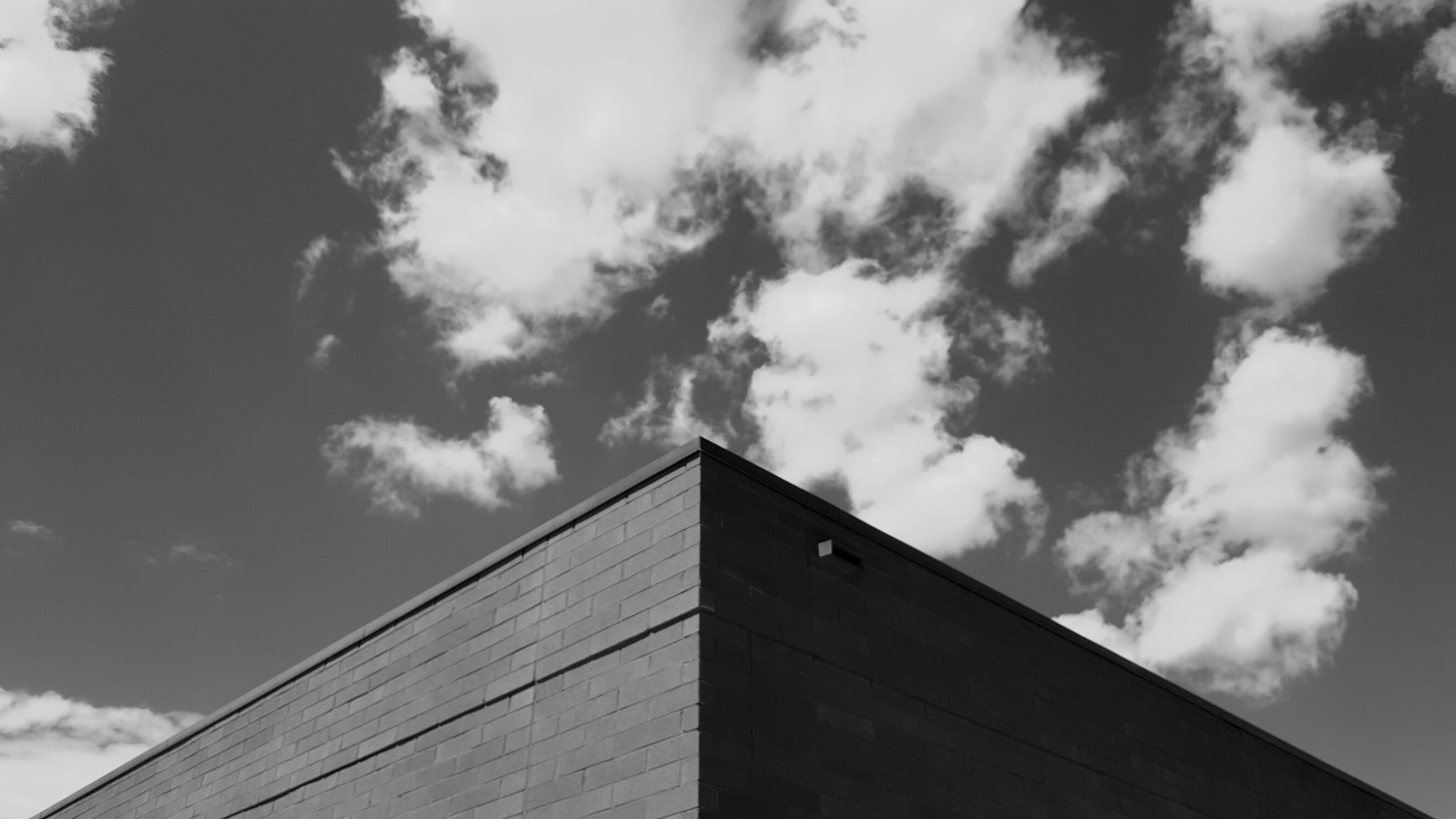 low angle view, sky, architecture, built structure, day, building exterior, outdoors, no people, cloud - sky, tree, nature