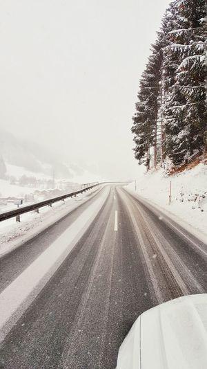 Car On Street During Snowfall
