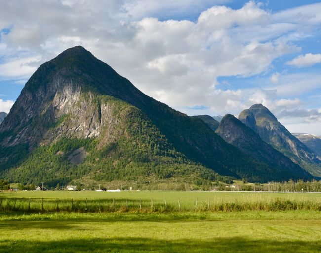 EyeEmNewHere Norway Beauty In Nature Cloud - Sky Day Environment Grass Green Color Idyllic Land Landscape Mountain Mountain Peak Mountain Range Nature No People Non-urban Scene Outdoors Plant Scenics - Nature Sky Tranquil Scene Tranquility