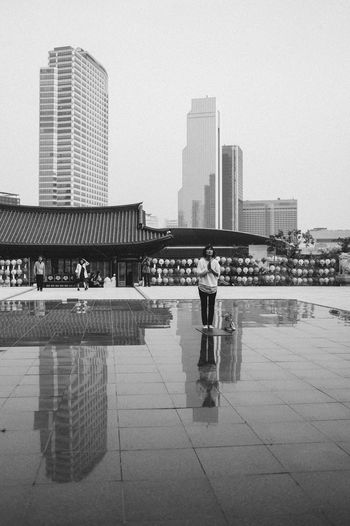 Pray Praying Reflection Reflections City City Life Cityscape Person Architecture Building Exterior Popular Photos EyeEm Best Shots Eye4photography  EyeEm Gallery Blackandwhite Black & White Black And White Monochrome Blackandwhite Photography Black And White Photography Skyscraper Sky National Geographic Buildings Black And White Friday