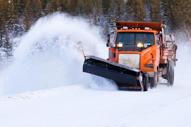 Snow plow truck clearing road after winter snowstorm blizzard for vehicle access Transportation Snow Mode Of Transportation Cold Temperature Winter Nature No People Outdoors Land Vehicle Motion Motor Vehicle Car Speed White Color Blizzard Vehicle Snow Plough Snowplough Snowplow Snowplowing Highway Road Truck Plow Plough
