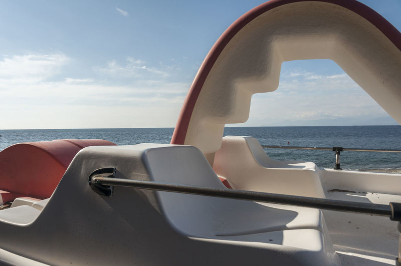 Pedal Boat On Sea Against Sky