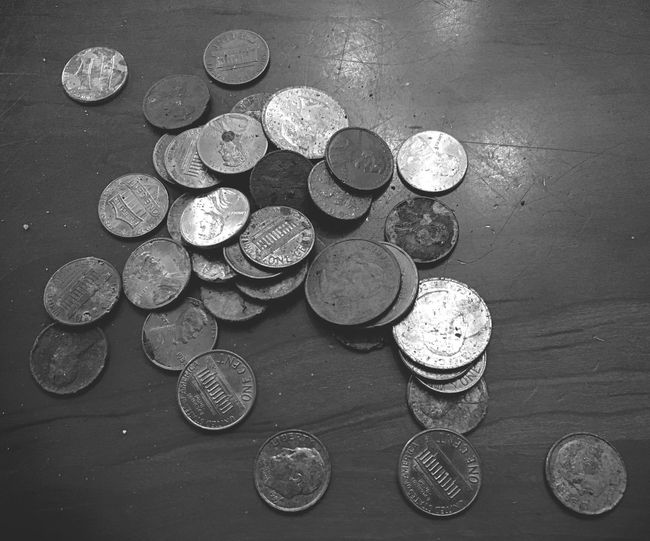 Spare change Many Of A Kind Things I See Shadow And Light Loose Change Spare Change Us Currency Coins On The Table Monochrome Black And White Coin Large Group Of Objects Currency Finance Table Indoors  Still Life High Angle View Wealth No People Close-up Abundance Savings Shape Metal Day Business Finance And Industry Business Variation