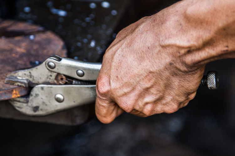 Adult Close-up Day Dirt Focus On Foreground Hand Hand Tool Holding Human Body Part Human Hand Men Occupation One Person Outdoors Real People Skill  Tool Work Tool Working