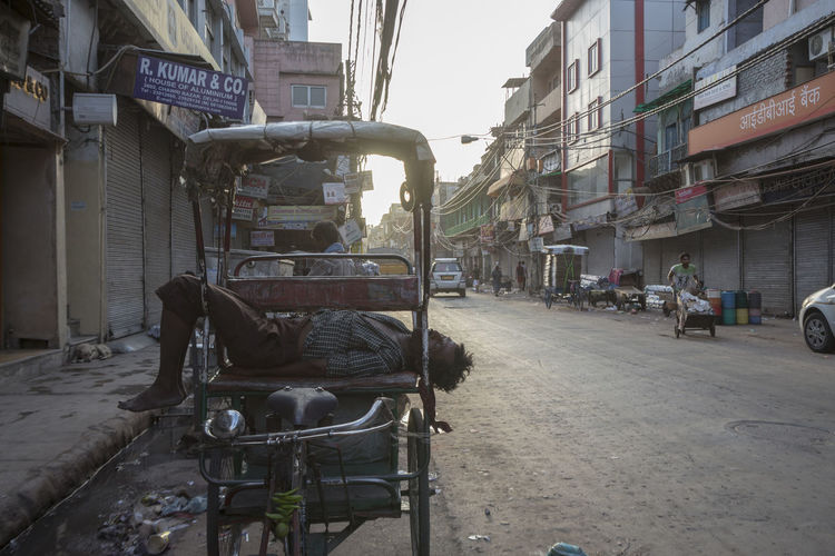 driver sleep in his rickshaw in morning at Chawri Bazar, Old delhi City City Life City Street Day Diminishing Perspective Hard Life Indianstories Indiapictures Land Vehicle Mode Of Transport Old Delhi Outdoors Parking Photowalk Riskchaw Sleeping Street Life Street Photography Streetlife The Way Forward