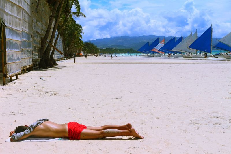 Feels like my bed. EyeEmNewHere EyeemPhilippines Under The Sun Adult Adults Only Beach Bikini Boracay Day Full Length Handstand  Lying Down Nature One Person Outdoors People Real People Sand Shirtless Sky Summer Vacations Young Adult An Eye For Travel