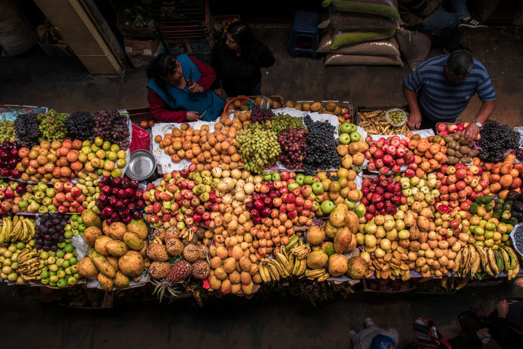 Food Healthy Eating Food And Drink Market Fruit Wellbeing Real People Abundance Group Of People Market Stall For Sale Freshness Men Retail  Small Business Business Choice Selling Large Group Of Objects People Outdoors Street Market Retail Display Sale Mercado