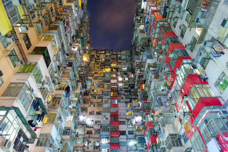 dense hongkong living Architecture Building Exterior City Built Structure Building Illuminated High Angle View Outdoors Motion Crowded Residential District People Day Incidental People on the move Real People Travel Destinations Skyscraper Apartment