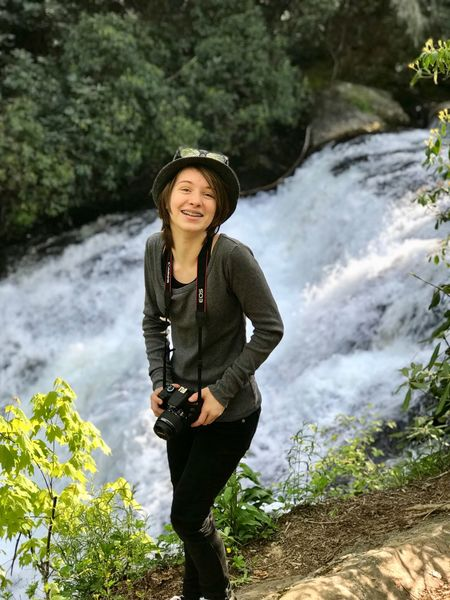 Aaron Blackwell Photography Photographer Waterfall One Person Leisure Activity Plant Water Nature Smiling Standing Hat Portrait Lifestyles Tree Young Adult Happiness Looking At Camera Outdoors Flowing Water The Portraitist - 2018 EyeEm Awards