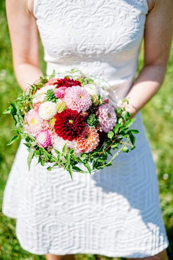 Nature Real People Flower Wedding Women Bride Celebration Hand Outdoors Plant Wedding Dress Bouquet Wedding Ceremony A New Beginning Freshness Adult Holding Flower Arrangement Front View Newlywed One Person Flowering Plant Life Events Flower Head Midsection Couple - Relationship EyeEmNewHere Standing