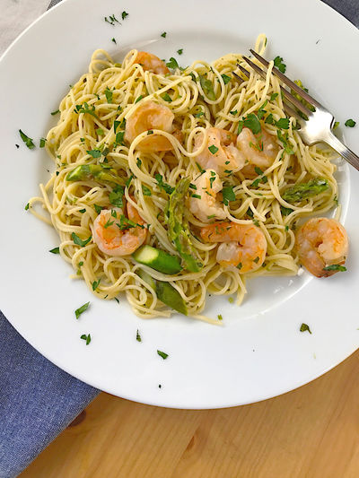 Directly above shot of spaghetti with shrimps on table