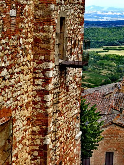 Italy🇮🇹 Montepulciano Toscana Italy Architecture Built Structure Building Exterior Brick Wall No People Day Outdoors Nature Close-up Old House On The Road Old House Balkony View From The Top View Over The Fields Below Old City EyeEm Gallery EyeEm Best Shots