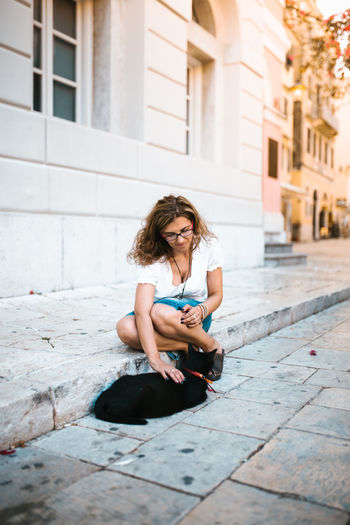 Young woman sitting in city
