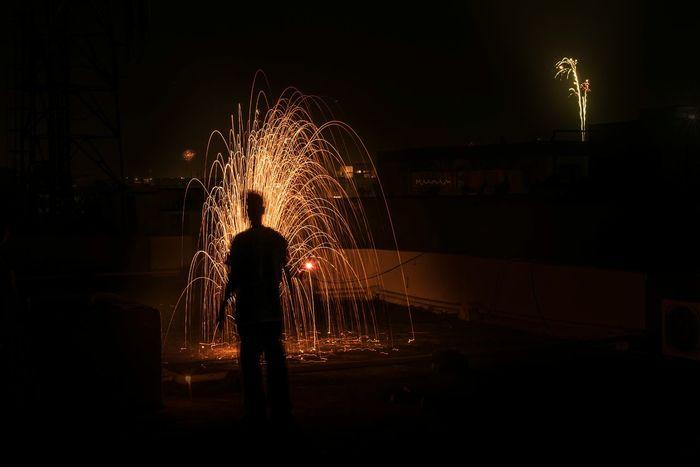 Welcome To Black Night Silhouette Celebration One Person Firework Display Nightlife One Man Only Diwali Celebration Festivaloflights Firecraker EyeEm Ready