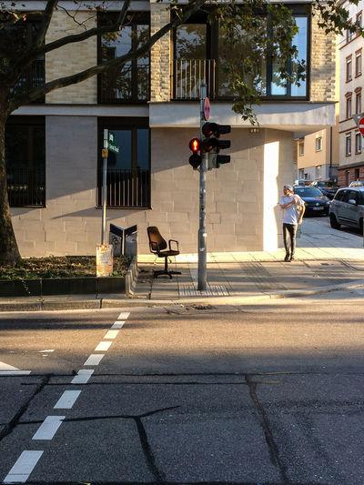 Have a Seat Chair City City Street Crosswalk Day Sidewalk Street Traffic Lights Transportation Waiting