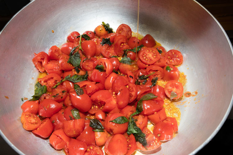 High Angle View Of Tomatoes In Cooking Pan