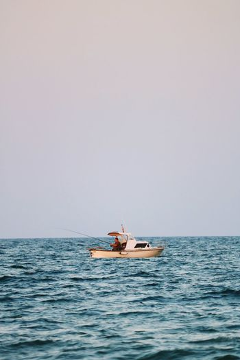 Water Nautical Vessel Transportation Sea Mode Of Transportation Sky Horizon Over Water Horizon Nature Copy Space Scenics - Nature Beauty In Nature Adult Outdoors Recreational Boat Men Day