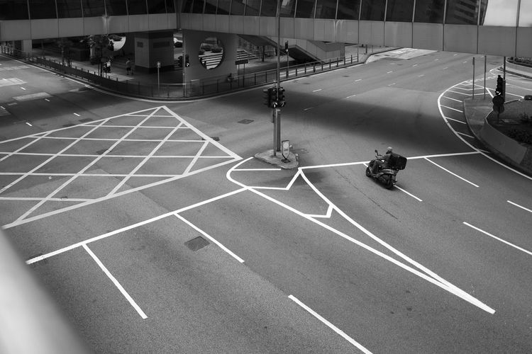 Symbol Marking Sign Transportation Road Marking Road City Land Vehicle High Angle View Mode Of Transportation Built Structure Architecture Street Real People Day Motor Vehicle Men Outdoors Car Communication Riding