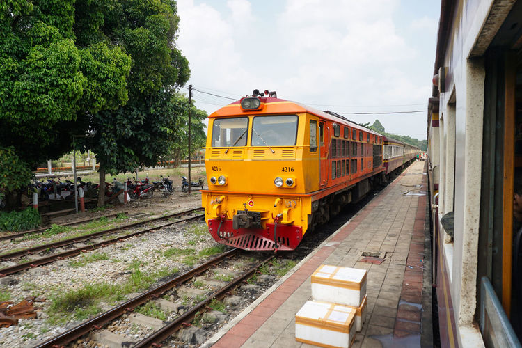 Alsthom Diesel Electric Locomotives State Railway of Thailand Alsthom Diesel Electric Locomotives Day Journey Land Vehicle Outdoors Public Transportation Rail Transportation Railroad Car Railroad Track Station Track Train Train - Vehicle Transportation Travel