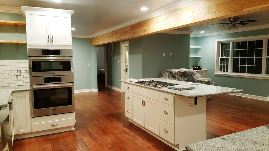 Cabinets in illuminated modern kitchen