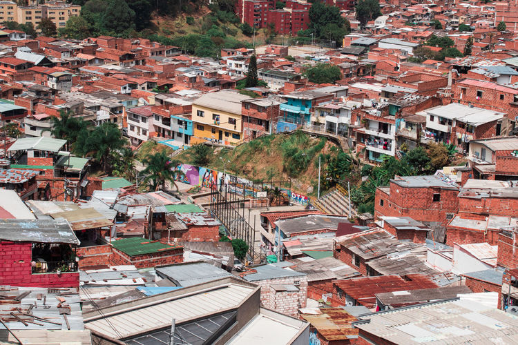 Medellin Colombia and the famous Comuna 13 Architecture Building Exterior Built Structure Building City Residential District Day Outdoors Roof House High Angle View Crowd Crowded Community Town TOWNSCAPE Tree Cityscape Settlement Comuna 13 Comuna Colombia Slums Ghetto South America Streetphotography Art Grafitti Tele Cable