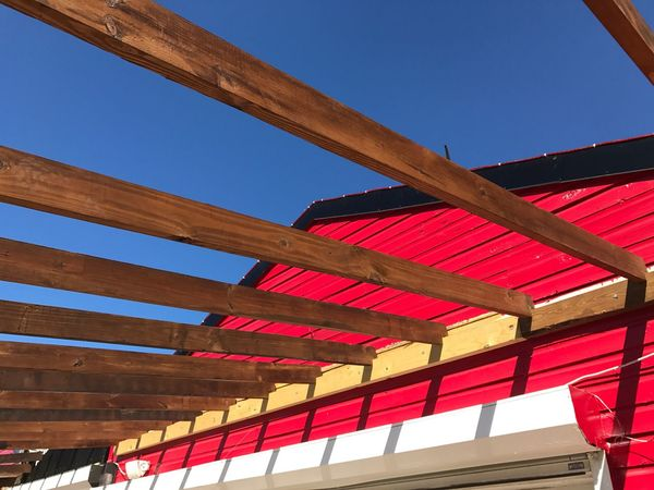 Wood - Material Red Red Paint Wood Wood Construction Blue Sky Caribbean Life Focus On The Story