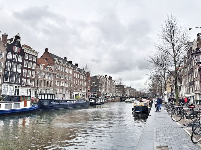 Waterway Amsterdam Amsterdam Canal Water City Sky Architecture Cloud - Sky Building Exterior Flood Storm Cloud Wet Rainy Season
