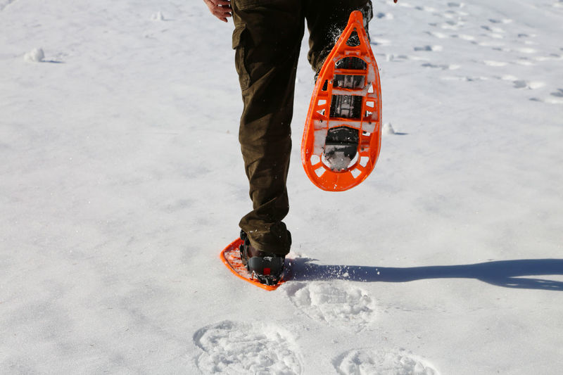 Young Boy runs walks with orange snowshoes and corduroy pants on white snow in mountains Cortina D'Ampezzo Excursion Pants Snow ❄ Snowshoe Walking Around Winter Adventure Boy Corduroy Corduroy Pants Cortina Extreme Sport Extreme Sports Legs_only Mountain Mountains Oudoors Outdoors Snowshoe Trip Snowshoeing Snowshoes Snowshoveling Sport Walking Around The City