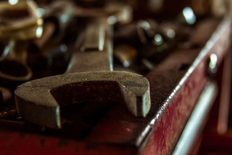 Close-up of rusty wrench on toolbox