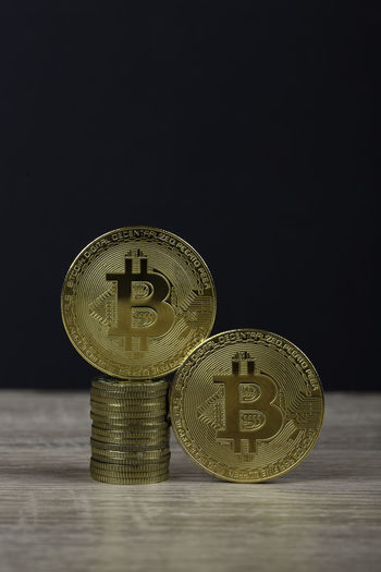 Close-up of coins on table against black background