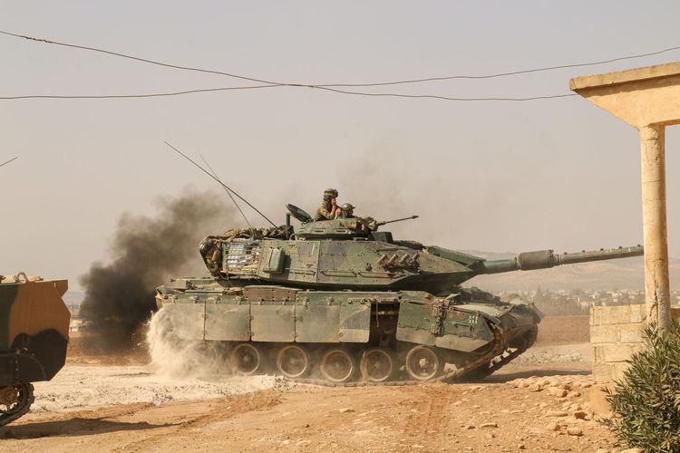 Men in armored tank