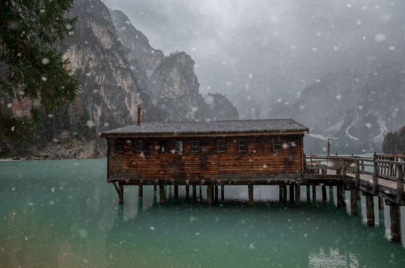Stilt House Over Lake During Snowfall