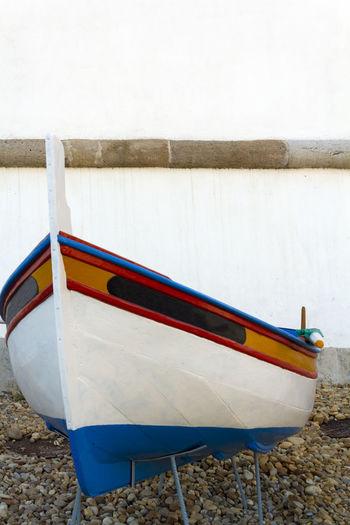 Boat moored on shore against lake