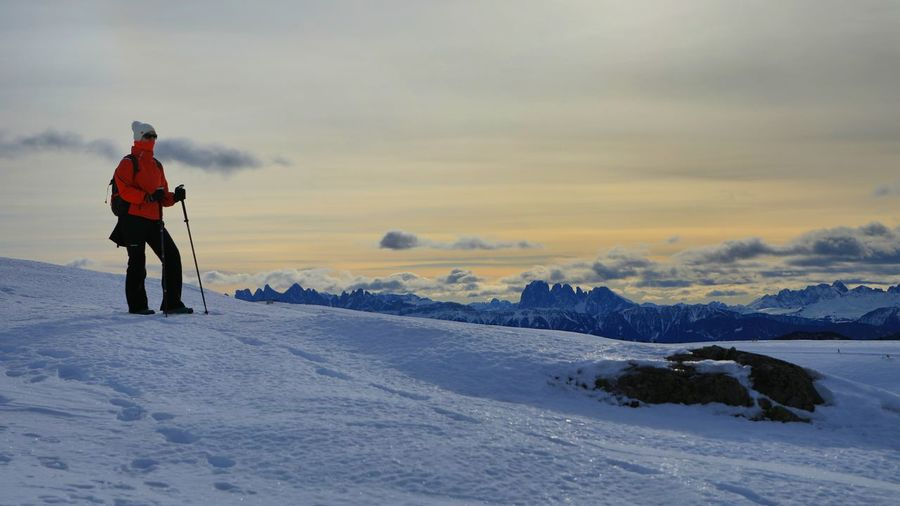 Rear view of man on snow against sky