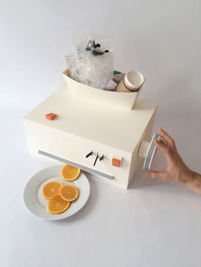 High angle view of cropped hand operating juicer with orange slices in plate on table