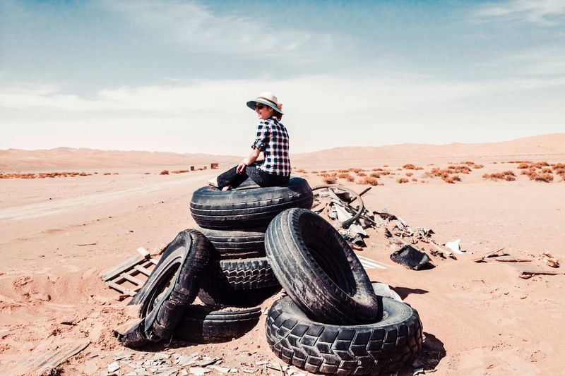 Sand Day Desert Outdoors One Person Real People Standing Sitting Sky Full Length Arid Climate Boys Childhood Nature Young Adult People The Great Outdoors - 2017 EyeEm Awards Liwa Lost In The Landscape