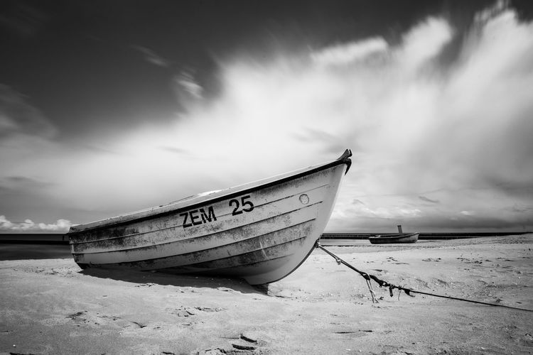 Cloud - Sky Sky Beach Sea No People Beauty In Nature Fishing Boat Sand Day Water Scenics - Nature Outdoors Moored Nautical Vessel Black And White