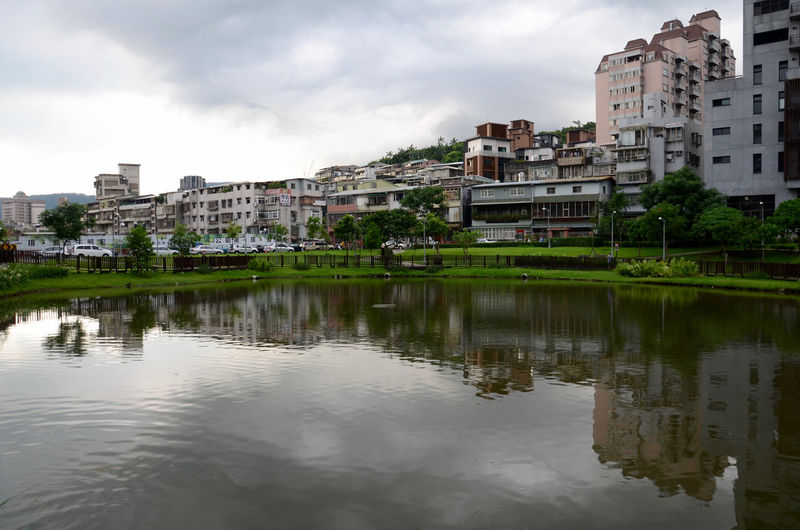 Architecture Building Exterior Built Structure City City Life Pond Reflections Pond Water Residential Building Residential District Residential Structure Sky