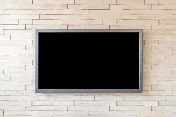 Blank Television Screen On Wall At Home