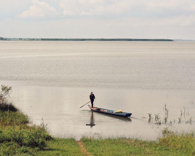 Man rowing boat in sea