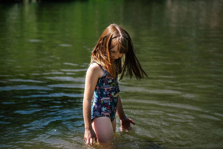 Full length of woman in lake