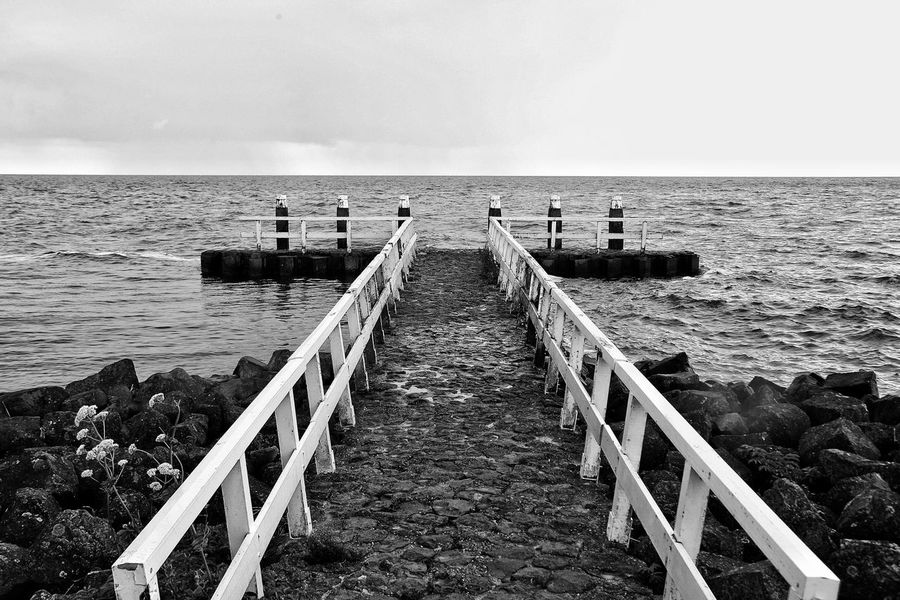 Horizon Over Water Sea Water Railing Pier Jetty Jetty View Jetty, Pier Sky Scenics Tranquil Scene Tranquility The Way Forward Nature Outdoors Tourism Seascape Beauty In Nature Shore Diminishing Perspective Non-urban Scene No People Ijsselmeer Finding New Frontiers